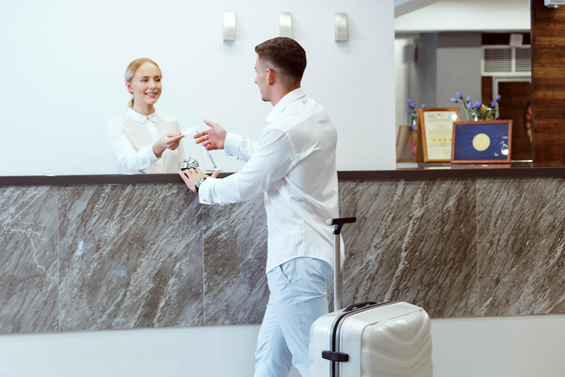 man-hotel-reception